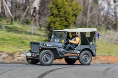 1943 Willys GPW Tourer driving on country road. Adelaide, Australia - September 25, 2016: Vintage 1943 Willys GPW Tourer driving on country roads near the town Stock Image
