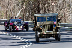 1942 Willys Jeep Utility driving on country road Royalty Free Stock Photo