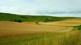 WilmingtonÂ的TheÂ长的人是aÂ在Windover小山nearÂ威明顿,东萨塞克斯郡,英国陡坡的小山figure 图库摄影