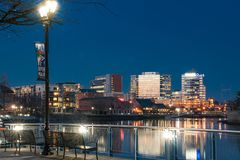 Wilmington, Delaware Skyline Along Christiana River at Night. WILMINGTON, DE - APRIL 5, 2018: Wilmington, Delaware Riverwalk and Skyline along the Christiana royalty free stock images