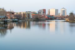 Wilmington, Delaware Skyline Along Riverwalk. WILMINGTON, DE - APRIL 5, 2018: Wilmington, Delaware Skyline and Riverwalk along the Christiana River stock photography
