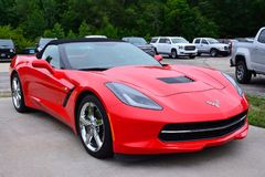 Red american sportscar Chevrolet Corvette. WILMINGTON, ILLINOIS, USA - JULY 16: Red american sportscar Chevrolet Corvette in the city street in Wilmington on Stock Image