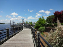 Wilmington, North Carolina Boardwalk. View looking back from far end of Wilmington, North Carolina's Riverwalk (boardwalk), along the Cape Fear River waterfront Royalty Free Stock Image