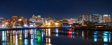 Wilmington skyline panorama. By night, reflected in Christiana River. Wilmington is the largest city in the state of Delaware Royalty Free Stock Photo