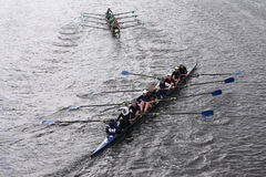 Wilson High School (top) Shrewsbury  HS(bottom)  races in the Head of Charles Regatta Women's Youth Eights Stock Image