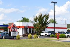 Exterior of Arby`s restaurant. WILSON, NC - MAY 20, 2017: An Arby`s restaurant in Wilson, NC. Arby`s is the second-largest quick-service fast-food sandwich Royalty Free Stock Photo