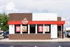 Exterior of Arby`s restaurant. WILSON, NC - MAY 20, 2017: An Arby`s restaurant in Wilson, NC. Arby`s is the second-largest quick-service fast-food sandwich Stock Image