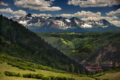 Wilson Peak Seen From Last Dollar Road Outside Telluride. Summer snow dapples the rocks crags of Wilson Peak outside Telluride, Colorado as seen from Last Dollar Stock Image