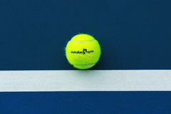 Wilson tennis ball with Australian Open logo on tennis court Stock Images