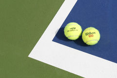 Wilson tennis balls on tennis court at Arthur Ashe Stadium Royalty Free Stock Photo