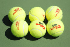 Wilson tennis balls on tennis court at Arthur Ashe Stadium Royalty Free Stock Image