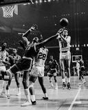 Wilt Chamberlain, Philadelphia 76ers. 76ers center Wilt Chamberlain fights for a rebound against the Boston Celtics in the 1968 NBA Playoffs Royalty Free Stock Photography