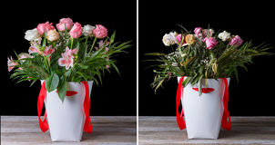 Wilted and fresh flower bouquet in the white boxes with red ribbons on a wooden table. On a black background. Royalty Free Stock Images