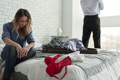 Wilted upset wife sitting on bed Stock Image