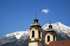 Wilten basilica and karwendel mountain range Royalty Free Stock Photo