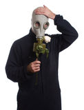 Wilting Rose. A guy wearing a gas mask is holding a wilting rose, isolated against a white background Royalty Free Stock Photo