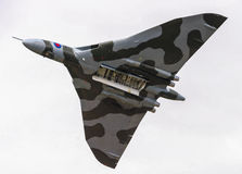 WILTSHIRE,UK - July 20 2014:Restored historic RAF Vulcan bomber dur. WILTSHIRE,UK - July 20  2014:Restored historic RAF Vulcan bomber during a flypast with open Royalty Free Stock Image