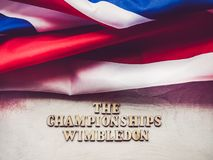 WIMBLEDON. Beautiful, bright photo for invitation card. WIMBLEDON. Wooden, unpainted letters on a white table. Close-up, top view. Beautiful photo for invitation stock image