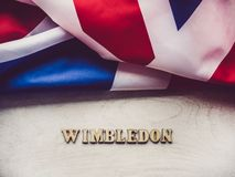 WIMBLEDON. Beautiful, bright photo for invitation card. WIMBLEDON. Wooden, unpainted letters on a white table. Close-up, top view. Beautiful photo for invitation royalty free stock photography