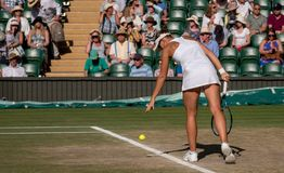 Victoria Azarenka playing the mixed doubles final on centre court, Wimbledon. royalty free stock photo