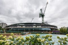Wimbledon Lawn Tennis championships Number 1 court roof being installed. Showing cranes and building materials royalty free stock images