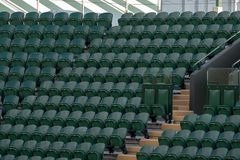 Rows of empty green spectators` chairs at Wimbledon All England Lawn Tennis Club. Wimbledon London. Rows of empty green spectators` chairs at Wimbledon All royalty free stock photos