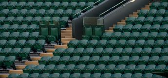 Rows of empty green spectators` chairs at Wimbledon All England Lawn Tennis Club. Wimbledon London. Rows of empty green spectators` chairs at Wimbledon All stock photography