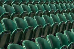 Rows of empty green spectators` chairs at Wimbledon All England Lawn Tennis Club. Wimbledon London. Rows of empty green spectators` chairs at Wimbledon All royalty free stock image