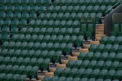 Rows of empty green spectators` chairs at Wimbledon All England Lawn Tennis Club. Wimbledon London. Rows of empty green spectators` chairs at Wimbledon All stock photo