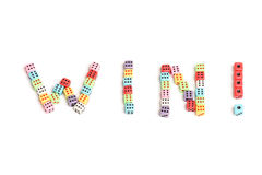 Win!. The word Win made of colorful dices Royalty Free Stock Photo