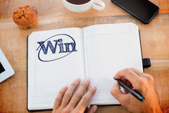 Win against man writing notes on diary Royalty Free Stock Photos