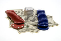 Win Big. Poker chips laying and 100 dollar bills (isolated, clipping path Royalty Free Stock Photos
