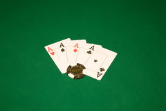 Win in the casino. Casino chips on the green table and four aces royalty free stock photo