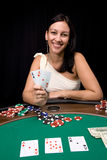 Win a chips in casino. Attractive young caucasian woman wins with two ace in the casino Stock Images