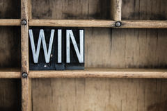 Win Concept Metal Letterpress Word in Drawer. The word WIN written in vintage metal letterpress type in a wooden drawer with dividers Stock Photo