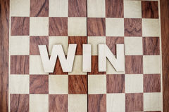 Win concept on wooden background. Win concept on the brown wooden background Royalty Free Stock Images