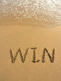 Win drawn on the beach Stock Photo