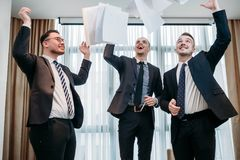 Win emotion papers air business deal celebration. Winning emotion and papers in the air. successful business deal or contract celebration. company managers happy Stock Images