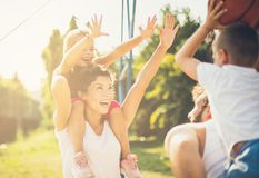 We win. Family playing basketball. Close up royalty free stock image