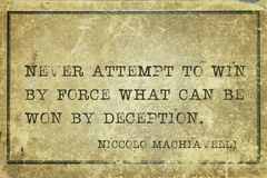 Win force Machiavelli. Never attempt to win by force what can be won by deception - ancient Italian philosopher Niccolo Machiavelli quote printed on grunge Stock Photo