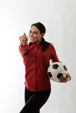 Win the game. Business woman holding a football Royalty Free Stock Photography