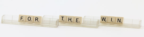 For The Win Letters. Travel Scrabble letter tiles spelling For The Win; white background Royalty Free Stock Photo