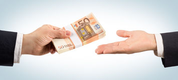 Win or loan of money. Give money in hand royalty free stock photo