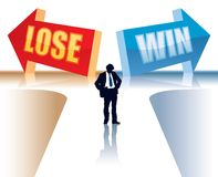 Win or lose. Businessman is standing in front of two direction signs Stock Images
