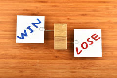 Win lose, two paper notes in different directions on wood Royalty Free Stock Image