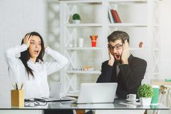 Win lottery concept. Surprised men and women at modern workplace. Win lottery concept Stock Photography