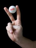 Win - lucky lottery winner. Hand holding winner lottery ball. Isolated win on black. Lucky winner lottery ball. Choose win ball. Victory sign - Lucky winning royalty free stock images