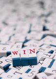 Win message. The word 'win' arranged with red letter blocks on messy background of other letter blocks royalty free stock photos