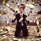 Win money. Businessman exults under a rain of money stock photography
