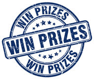 Win prizes blue grunge round stamp Royalty Free Stock Images